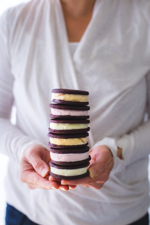 Someone holding a stack of ice-cream sandwiches.