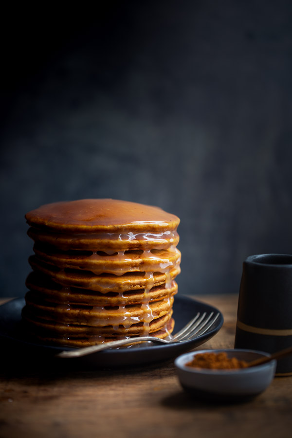 Gingerbread Pancakes with Lemon Sauce - Perfect for fall, these fluffy pancakes are flavored with cinnamon, ginger, and molasses and served with a lemon sauce. | tamingofthespoon.com