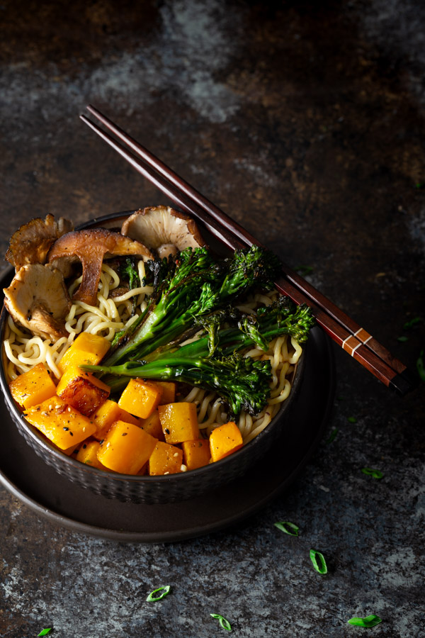 A bowl of miso ramen with roasted mushrooms, butternut squash, and broccolini.