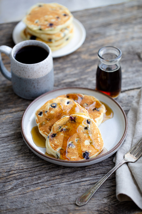 Family Favorite Buttermilk Pancakes - Light and fluffy, these classic buttermilk pancakes are perfect with maple syrup. Add blueberries or chocolate chips to make them even better.