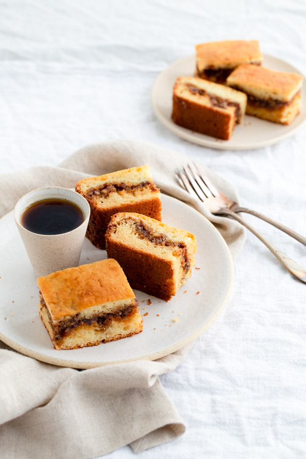 Two plates with slices of coffee cake.