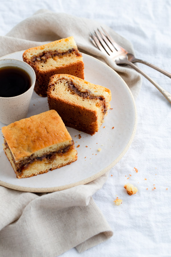 Slices of coffee cake on a white plate.
