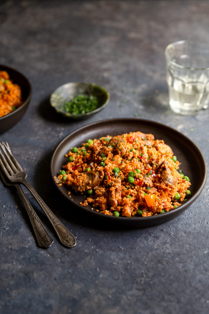 Chicken and Sausage Paella with Couscous - authentic paella flavors made quick and easy with couscous and boneless chicken thighs. Great for a weeknight dinner!