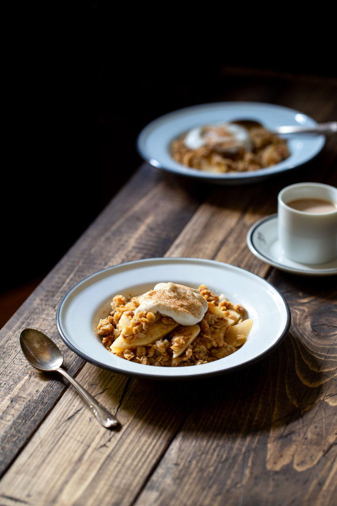 Breakfast Apple Crisp - Sliced apples baked with a crunchy topping of oats, maple syrup, and brown sugar. It's a cozy, healthy way to start your day.
