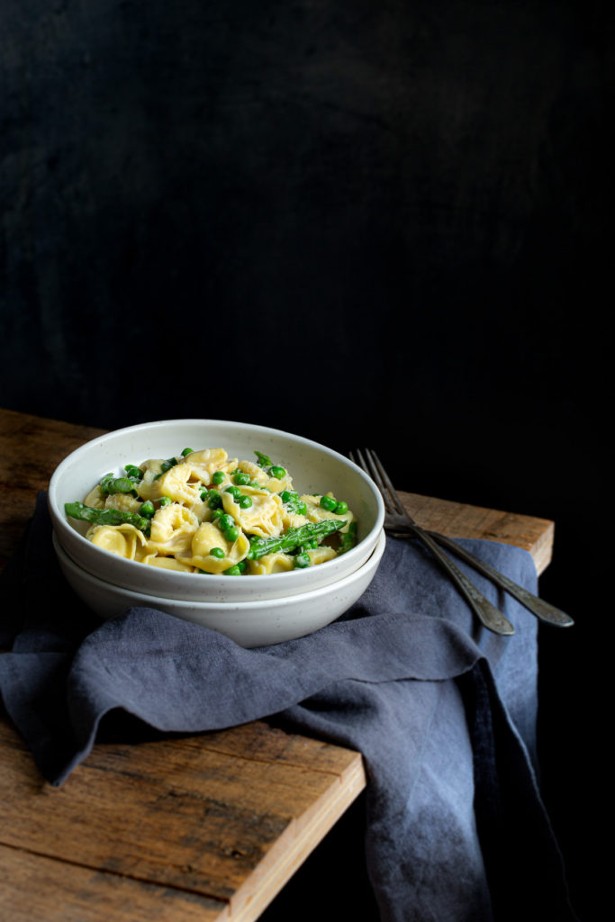Easy Tortellini Carbonara with Peas and Asparagus - the easiest pasta carbonara ever. You only need 6 ingredients, 1 pan, and 20 minutes.