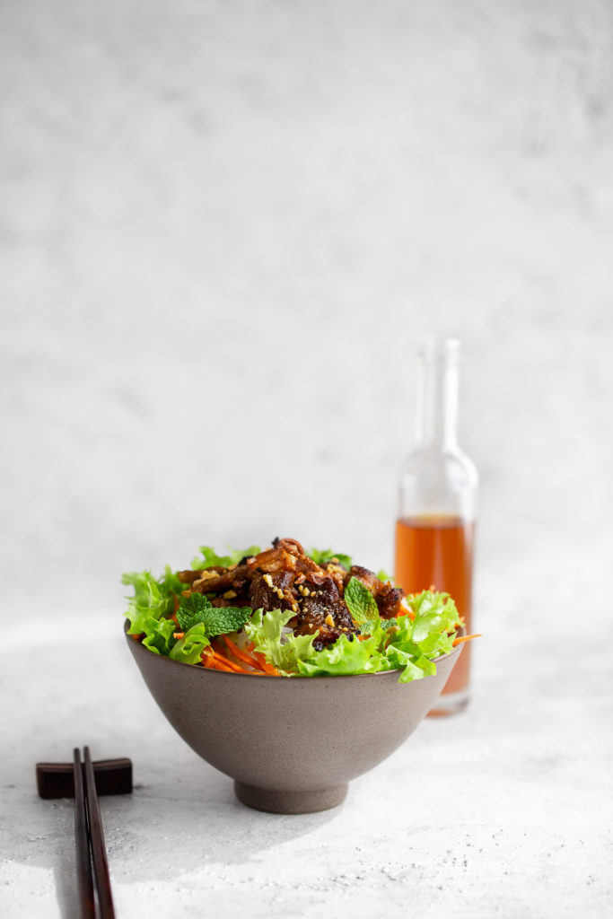 Authentic Vietnamese rice noodle bowl with marinated grilled pork and served with lots of fresh vegetables and a fish sauce dipping sauce.