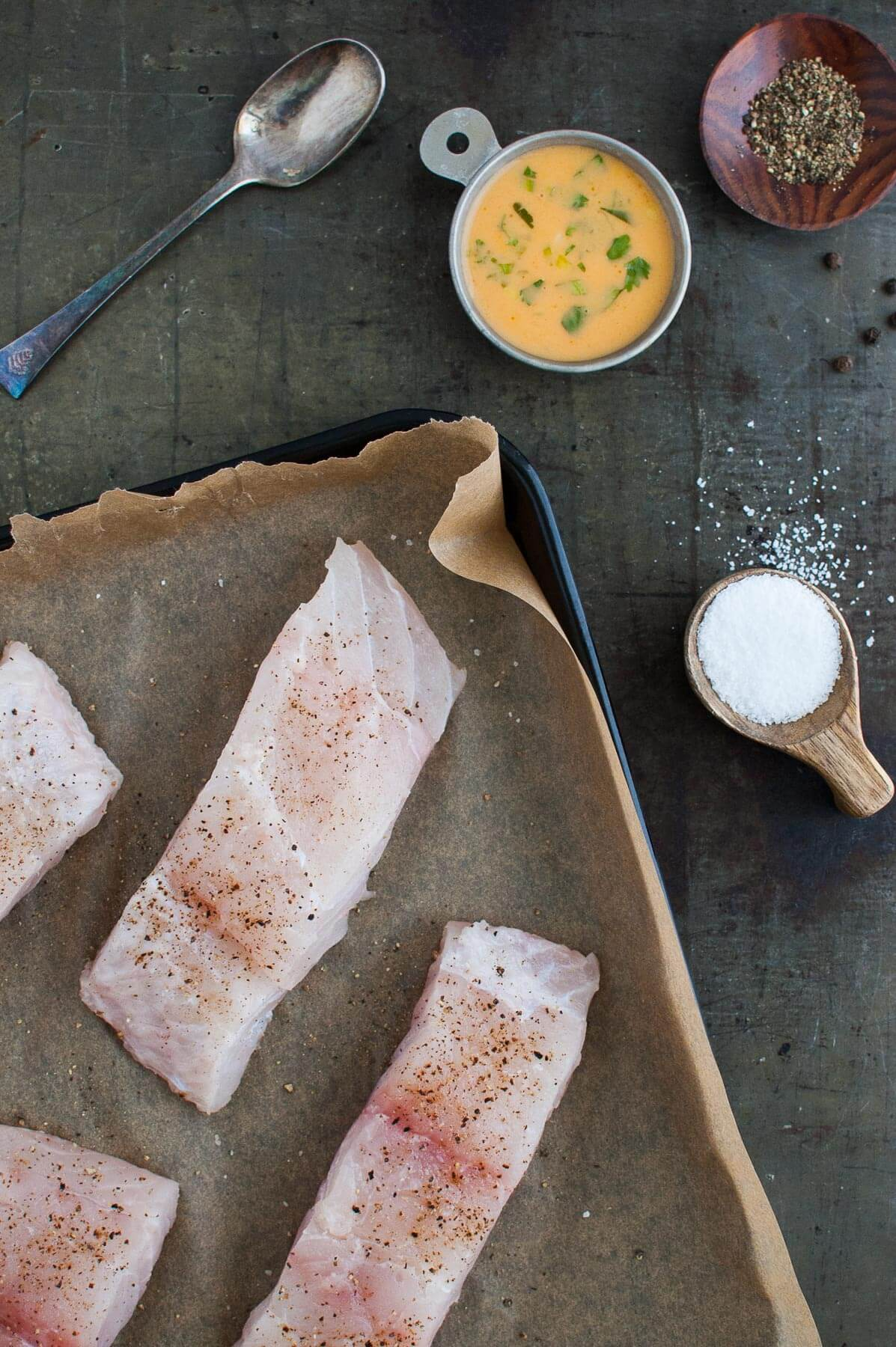 Mahi-mahi fillets with Thai coconut curry sauce, salt, and pepper.