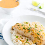 Plate of mahi-mahi with Thai coconut curry sauce and steamed rice.